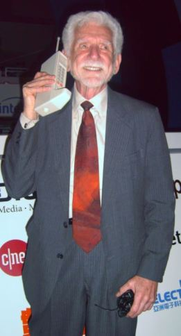 Martin Cooper of Motorola made the first publicized handheld mobile phone call on a prototype DynaTAC model on April 3, 1973. This is a reenactment in 2007.