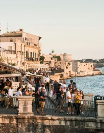 In Syracuse, taking a passeggiata, or evening walk, around the perimeter of Ortigia island, is a popular activity.CreditCreditSusan Wright for The New York Times