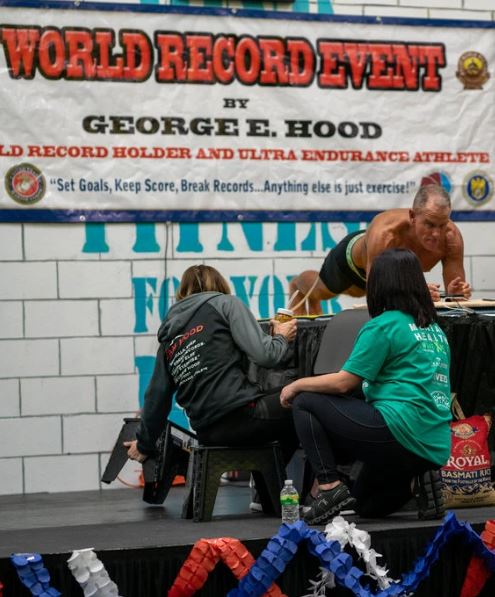 Mr. Hood, a former Marine and Drug Enforcement Administration agent, held a plank for eight hours, 15 minutes and 15 seconds.Credit...Josef Holic