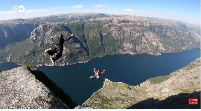 Extreme Sports Views: Base Jumping Off Kjerag Cliff In Lysefjord, Norway